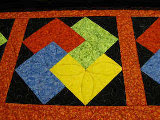 Modified Orange Peel on Card Trick Quilt, quilted by Angela Huffman