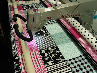 Fun and Flirty French Inspired Quilt on the APQS Millie - QuiltedJoy.com