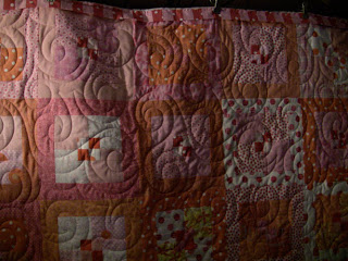 Polka Dot Party Quilt with Swirl edge to edge quilting by Angela Huffman - QuiltedJoy.com