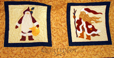 Eve's Santa Applique Quilt with custom quilting by Angela Huffman - QuiltedJoy.com