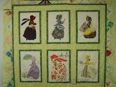 Calendar Hankie Quilt hanging on the design wall, just waiting for the inspiration! - QuiltedJoy.com
