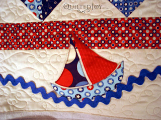 Baby Sailor quilt with custom quilting by Angela Huffman - QuiltedJoy.com