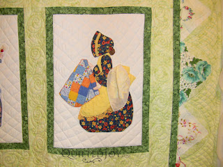 March block in a Hankie Lady Obsession Quilt with custom quilting by Angela Huffman - QuiltedJoy.com