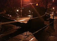 tornado damage at night-sidewalk upheaval