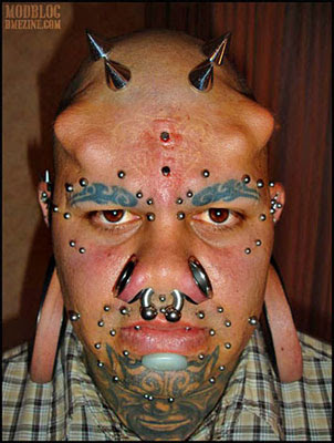 extreme body piercing and implants