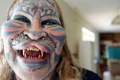 body piercing and tattoo tiger style
