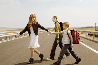 Still from the film Home - crossing the road to go to school