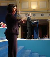 A sign language interpreter suddenly appeared at the start of Gerry Adams' closing speech