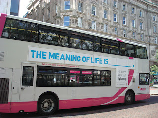 Alpha poster on the side of a Metro bus asking - The Meaning of Life is _______