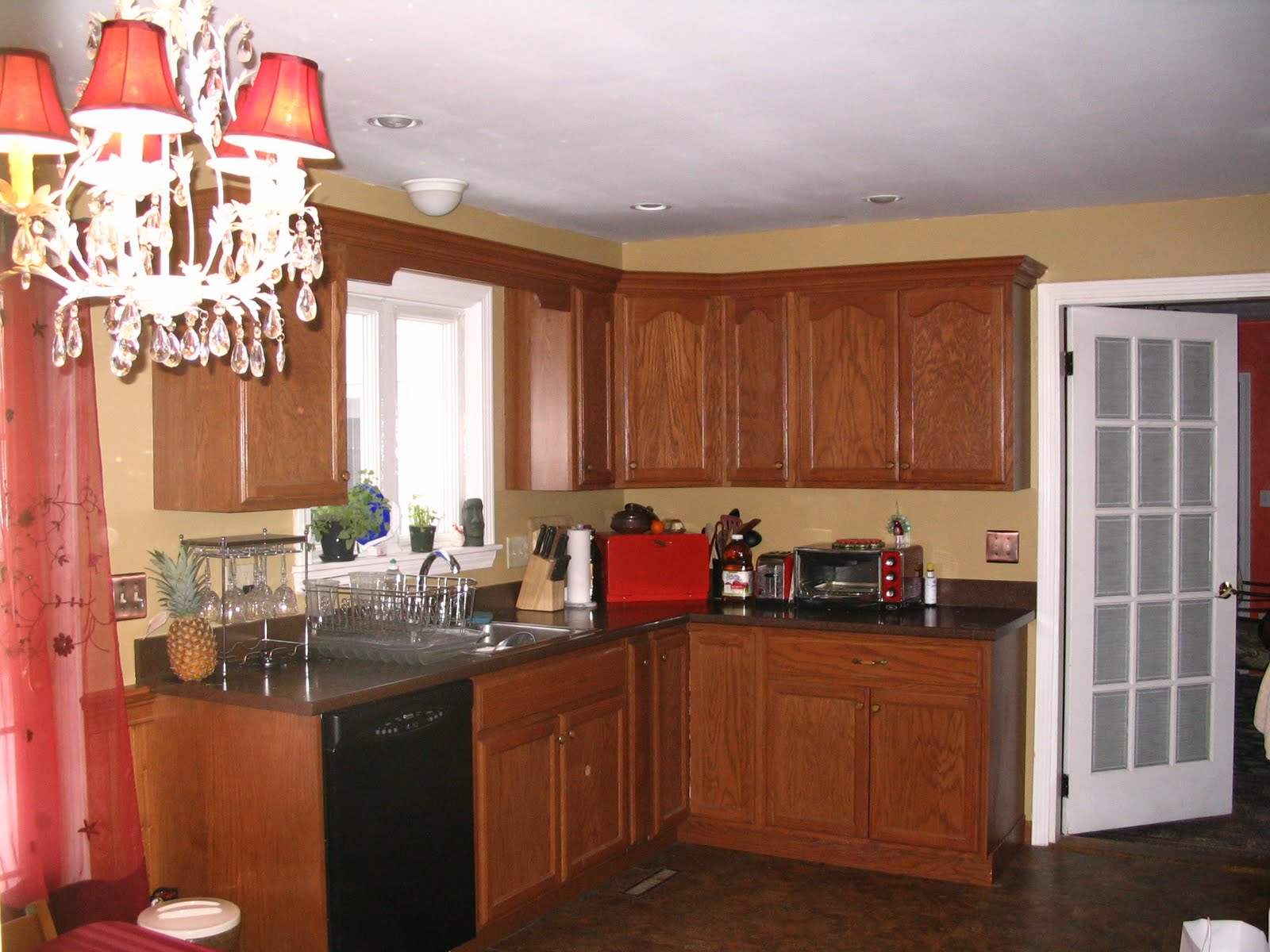 Kitchen with Oak Cabinets Dark Floor Light