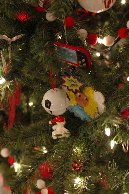 Decorate Christmas tree with yearly family ornaments