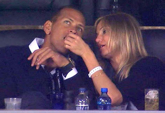 Cameron Diaz feeds Alex Rodriguez popcorn at the Super Bowl