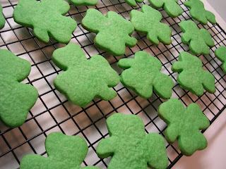 baked green shamrock sugar cookies on a cooling rack