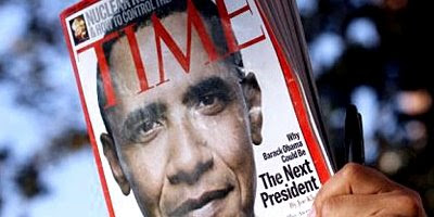 A rally attendee holds a Time magazine with United States Senator Barack Obama on the cover. Photograph: Paul Buck/EPA