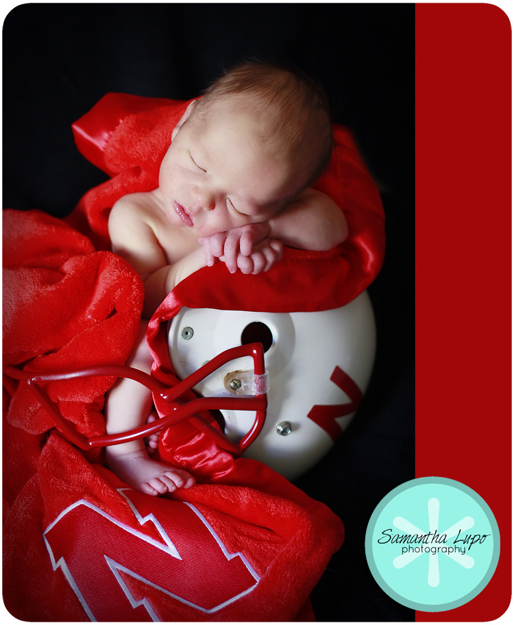 Toward the end we got baby k to calmly sit in a football helmet he filled the whole thing c