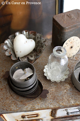 Mini molds, an old clock face and a small glass bottle