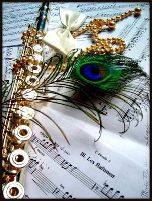 flute and peacock feathers