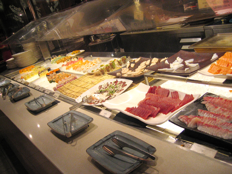 array of sashimi and sushi