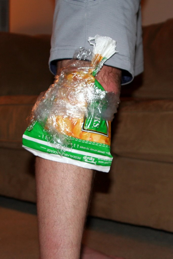 frozen fruit attached to knee with saran wrap