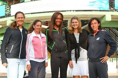 Black Tennis Pro's Venus Williams poses with the WTA players council