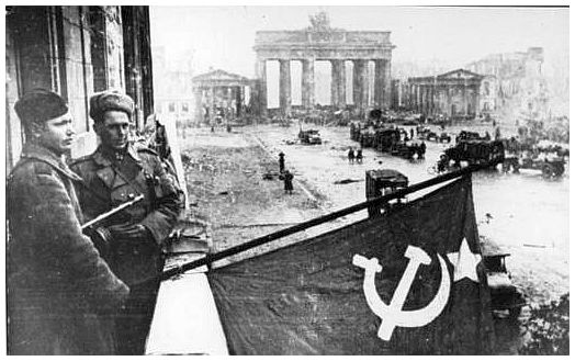 soviet-soldiers-wave-flag-berlin-second-