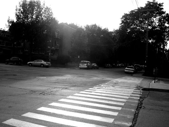 black and white photo, crosswalk, intersection, empty street