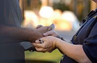 Close photograph of a fema worker shaking a disaster victim's hand
