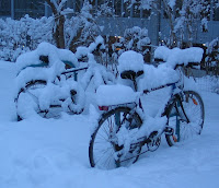 Bicycles in the snow near the campus of the University of Graz, Austria, at dawn on 27 Dec 2005. Picture taken and uploaded by Dr. Marcus Gossler.