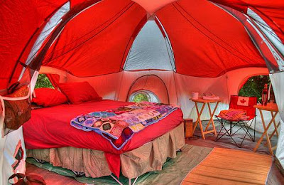 A camping tent in beautiful red