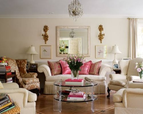 another room of non matching furniture styles pulled together by color and personal collections - Matching Chairs For Living Room