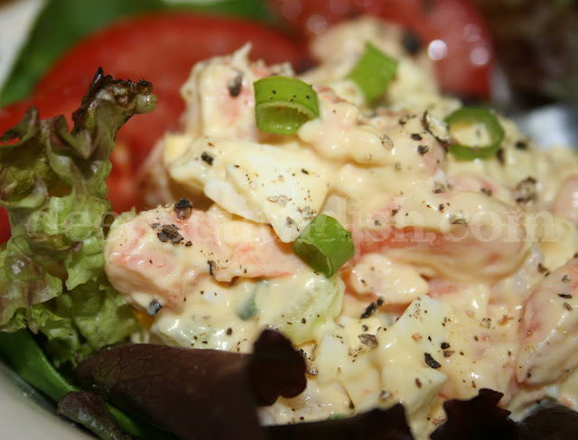 A favorite egg salad, made very simply with the addition of shrimp, green onion, celery and mayonnaise. Serve with crackers, as a sandwich, or stuffed into a tomato. Light and delicious!