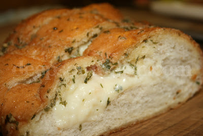 French bread stuffed with gooey cheese and smeared with a garlicky, parsley butter blend. An indulgence for sure, but so worth it!