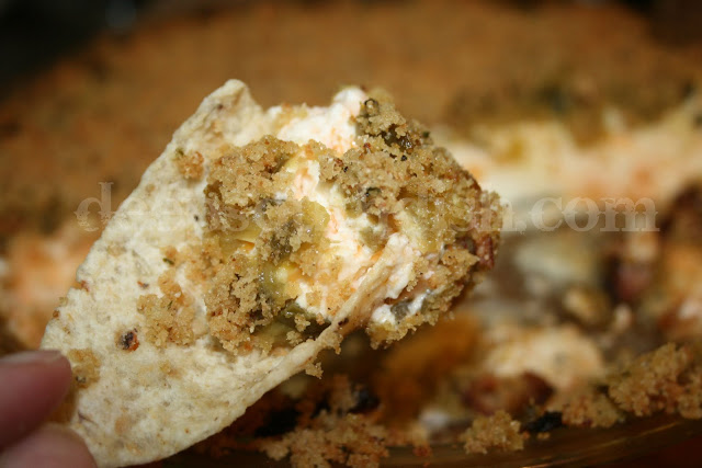 Like a deconstructed jalapeno popper, this dip is made with jalapenos, green chilies, cream cheese, parmesan and cheddar, and topped with a buttery bread crumb.