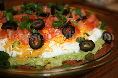 A retro throw-back to the 70s and still popular today, 7 layer dip is made with refried beans, avocado or guacamole spread, sour cream, shredded cheese, tomatoes, black olives and green onion, and is still a party favorite.