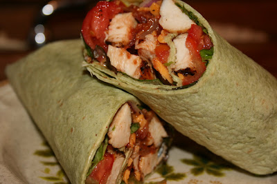 Boneless, skinless chicken breast, seasoned generously and grilled, sliced and wrapped along with some veggies, in a flour tortilla.