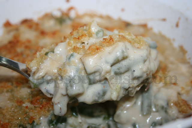 A few little twists on the old classic, this green bean casserole, includes freshly sauteed onion, sliced almonds, and a buttery crumb topping.
