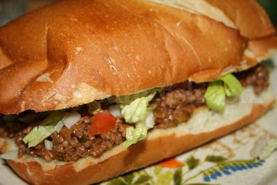 Dry onion soup mixed with ketchup, mustard and sweet pickles, combined with cooked ground beef, makes this loose meat sandwich sort of like a deconstructed hamburger.