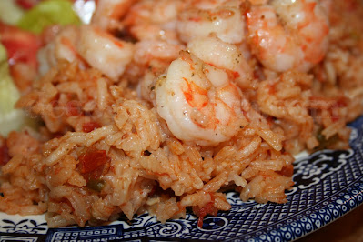 Similar to Spanish rice, red rice is a blend of vegetables, tomatoes, rice and of course for us along the Gulf Coast, our sweet, Gulf-fresh shrimp.