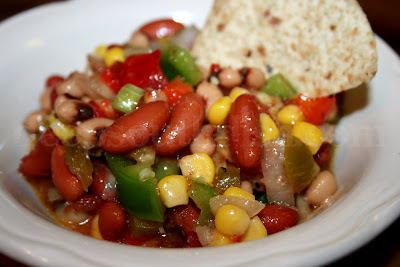 Texas Caviar, done up my way, Mississippi style. Sort of a take on a bean salad really, it's simply a mixture of your favorite canned beans, usually the addition of corn, and a variety of chopped raw vegetables, all tossed in a vinaigrette.