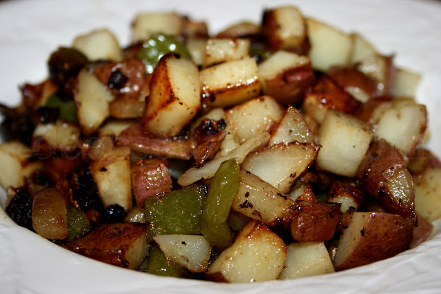 Red skin potatoes are fried up in a cast iron skillet with sweet Vidalia onion and bell pepper and nicely seasoned for a take on Potatoes O'Brien. Great for any meal - add bacon, ham, sausage, fresh herbs and mushrooms if you like!