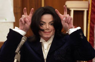 Michael Jackson doing a funny hand gesture in 2007.
