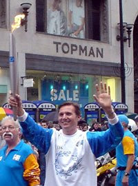 Roger Black runs through Oxford Circus