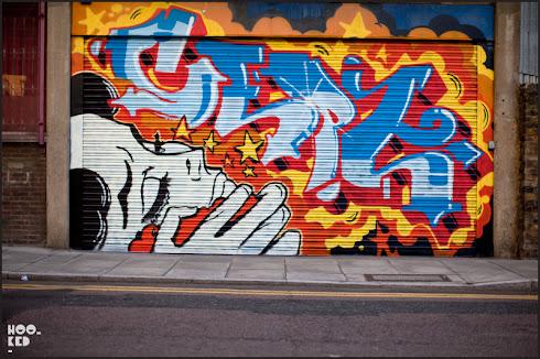 Roller SHutter Street Art in East London by artist Cept
