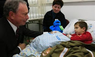 New York City Mayor Michael Bloomberg speaks to a hospitalized Israeli boy