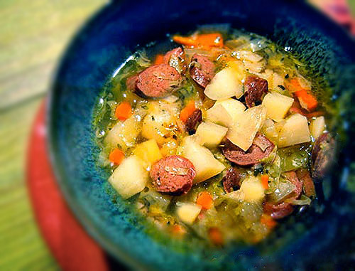 A bowl of Irish potato and sausage soup.