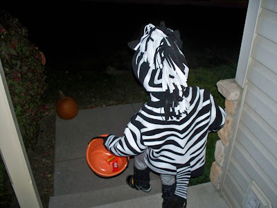 Lilly running out the door on a night of trick or treating