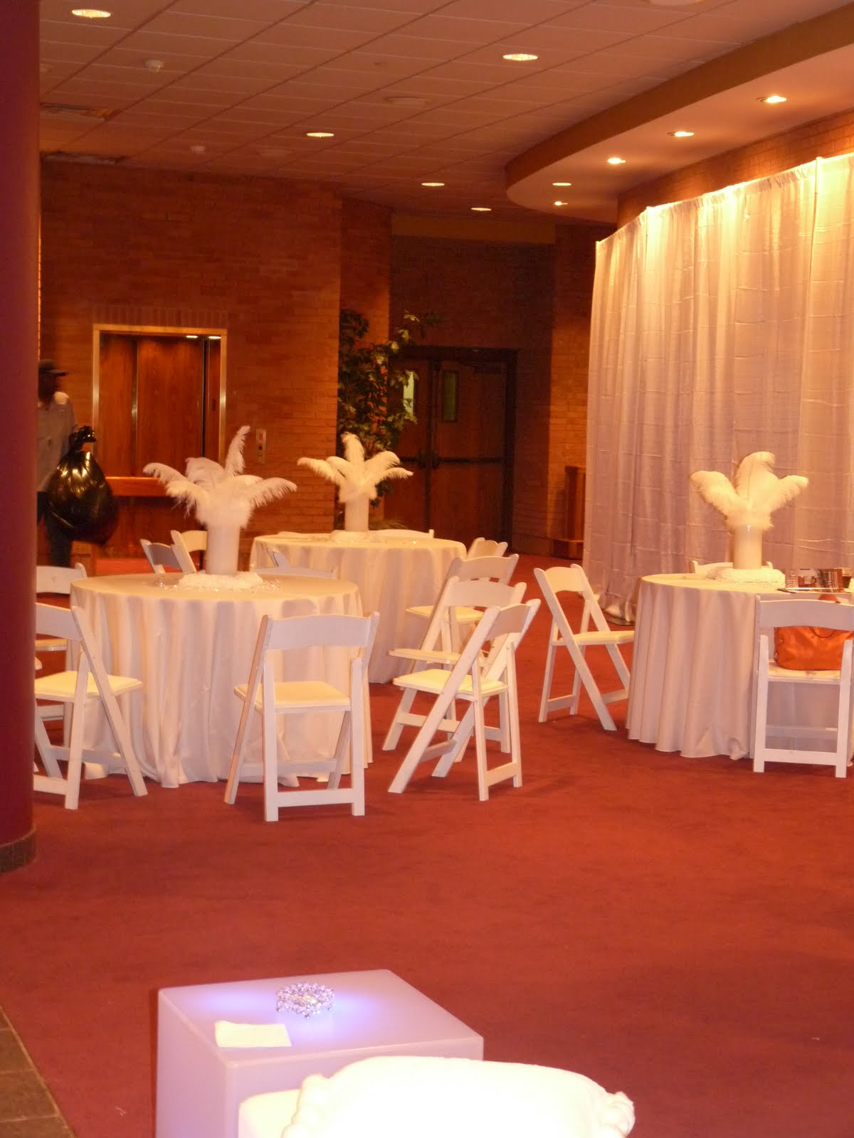 538c92b42f2 We love using feathers as centerpieces! This is just another angle of the  lobby.