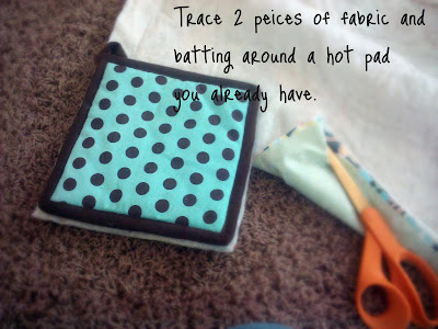 Hot pads, scissors and fabric with instructions on how to make a hot pad.