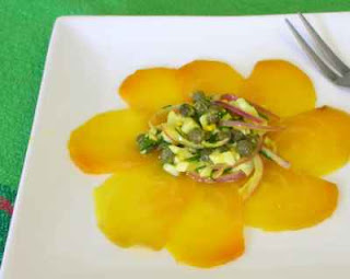 Thin slices of golden beet, topped with a bit of caper & egg salad