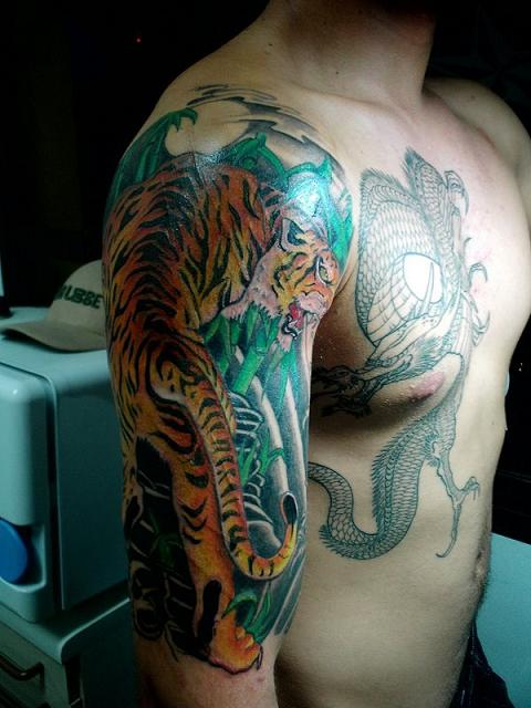 top tattoo designs: Chest Dragon Tattoo